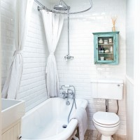 Bathroom with white metro tiles and freestanding bath