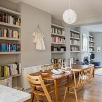 Open-plan family living and dining room with connecting shelves