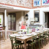 Traditional dining room with exposed brick walls