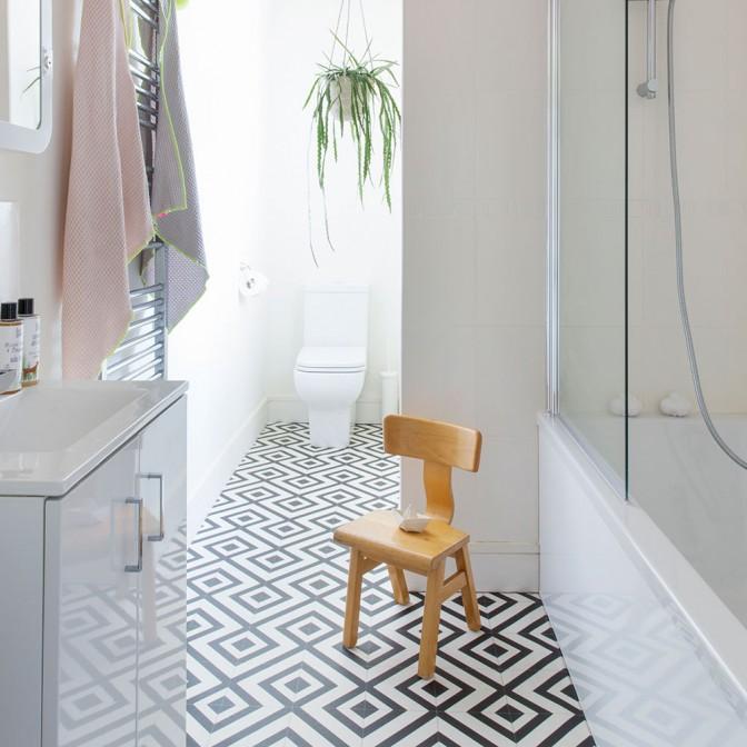 Modern monochrome bathroom with geometric vinyl floor tiles