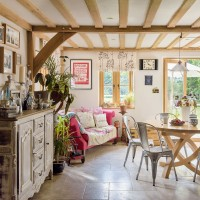 Beamed open-plan country dining room
