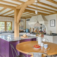 Country kitchen with purple island unit