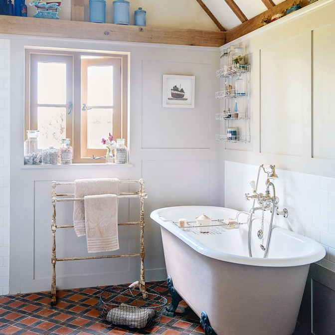 Panelled country bathroom with freestanding bath