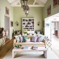 Classic green living room with vaulted ceiling