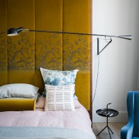 Modern bedroom with luxe yellow headboard
