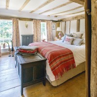Country bedroom with warm red accessories