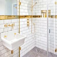 Elegant white bathroom with gold details