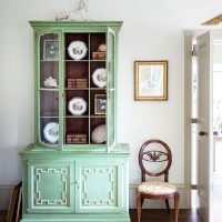 Elegant hall with celadon green dresser