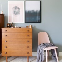 Grey bedroom with retro chest of drawers