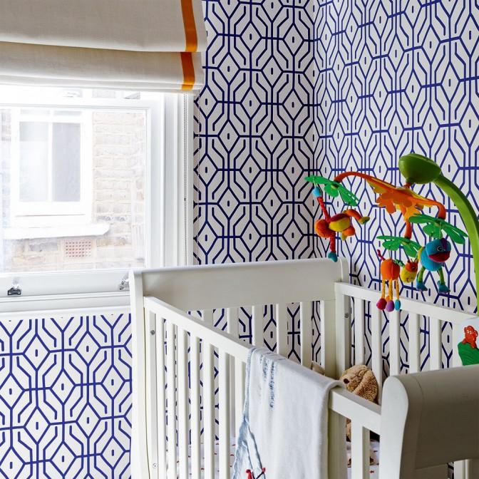 Modern nursery with geometric wallpaper