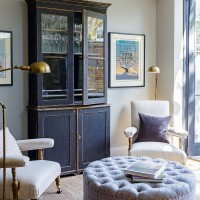 Neutral living room with bold blue furniture