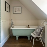 Small bathroom with roll top bath and sloping ceiling
