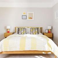 Neutral modern bedroom with yellow bedlinen