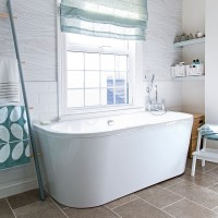 Modern nautical bathroom with freestanding bath