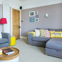 Grey living room with modern yellow accessories