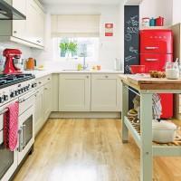 Modern neutral kitchen with bold red fridge