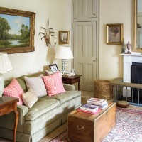 Traditional living room with small green sofa