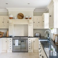 Traditional kitchen with mantel over range cooker