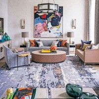 Neutral living room with brightly coloured artwork