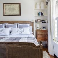 Classic bedroom with monogrammed linen