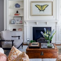 Classic white living room with leather trunk