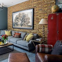 Family living room with exposed brick wall