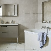 Neutral bathroom with tiled-front bath