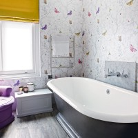 Traditonal bathroom with pretty butterfly wallpaper