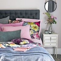 Pink and grey bedroom with dark botanical cushions