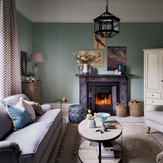 Elegant Green Living Room With Traditional Fireplace
