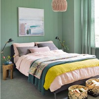 Modern green bedroom with pink accessories
