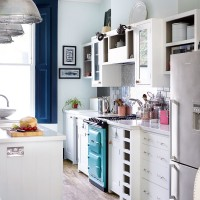 Traditional white kitchen with aqua blue range cooker