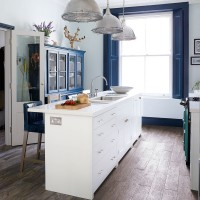 Deep blue and white French-style kitchen