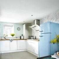 Modern green and white kitchen with retro fridge
