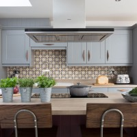 Blue painted kitchen with patterned tiles