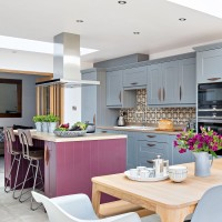 Blue and plum kitchen-diner with island unit