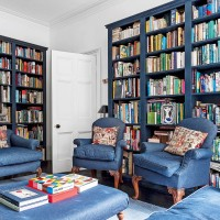 White living room with deep blue bookcases
