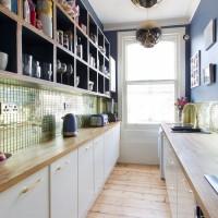 Modern kitchen with gold splashback tiles