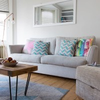 Modern grey living room with pastel accessories