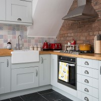 Compact kitchen with exposed brick wall