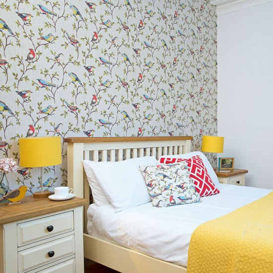 Pretty bedroom with bird-theme wallpaper