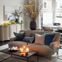 Living room with twinkling fairy lights and candle flame