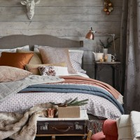 Neutral bedroom with layers of texture and copper touches