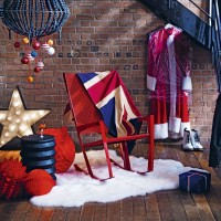 Industrial-style hallway with festive decorations and red chair