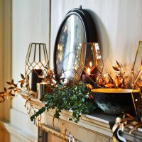 Festive mantelpiece with gold accents and foliage