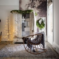 Cosy white bedroom with rocking chair