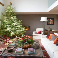 Cosy panelled living room with snow-sprinkled Christmas tree