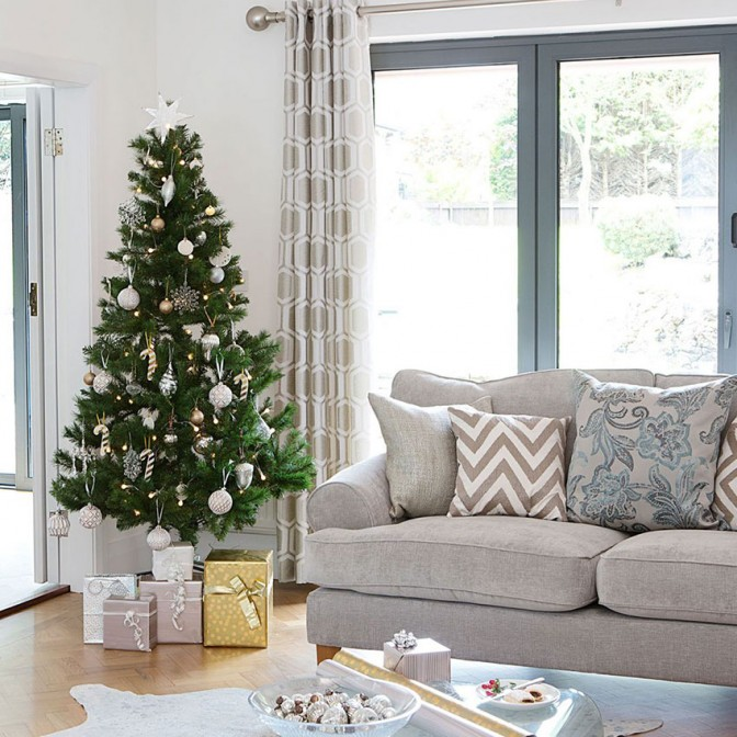 Christmas modern living room with grey sofa and patterned cushions