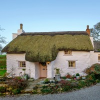 Step inside this idyllic thatched cottage with gorgeous Scandi interior