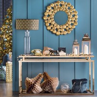 Peacock blue hallway with gold console table and mirror
